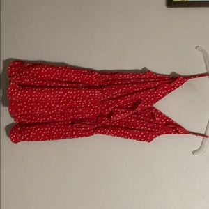 Red romper with white polka dots